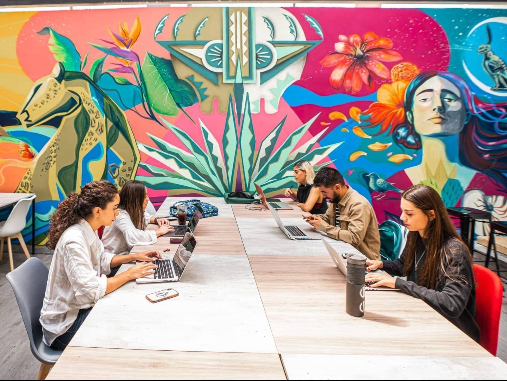 Young people working at the coworking space of U-Co